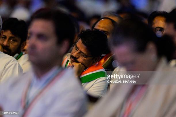 A member of the All India Congress Party sleeps during the 48th Congress plenary session in New Delhi on March 17 2018 Rahul Gandhi's unopposed...