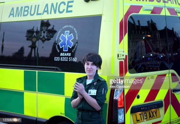 A member of the Ambulance Service applauds on Westminster Bridge on April 23 2020 in London United Kingdom Following the success of the Clap for Our...