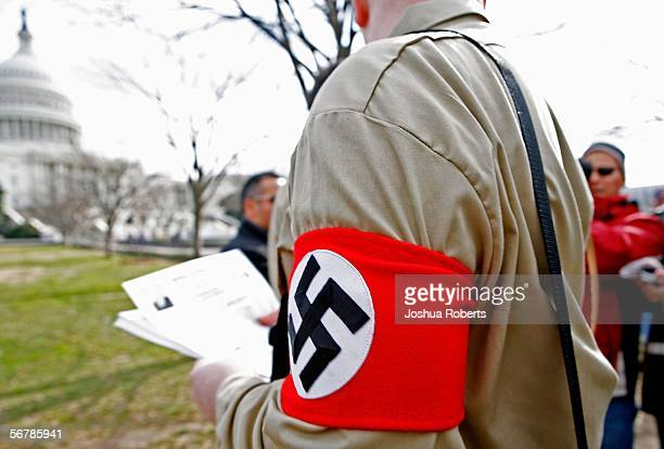 Member of the American Nazi Party is led from a rally held by the Minuteman Project on Capitol Hill February 8, 2006 in Washington, DC. Two members...