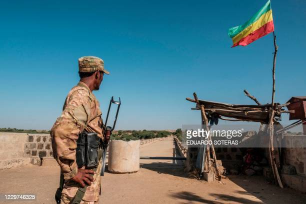 Member of the Amhara Special Forces watches on at the border crossing with Eritrea while where an Imperial Ethiopian flag waves, in Humera, Ethiopia,...