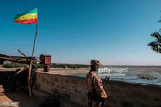 Member of the Amhara Special Forces watches on at the border crossing with Eritrea where an Imperial Ethiopian flag waves, in Humera, Ethiopia, on...