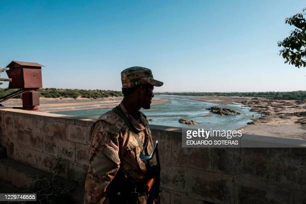 Member of the Amhara Special Forces watches on at the border crossing with Eritrea, in Humera, Ethiopia, on November 22, 2020. - Prime Minister Abiy...