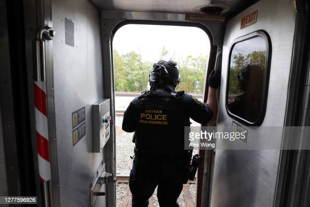 Member of the Amtrak Police Special Operation Unit guards the campaign train of Democratic presidential nominee Joe Biden at campaign stop at the...