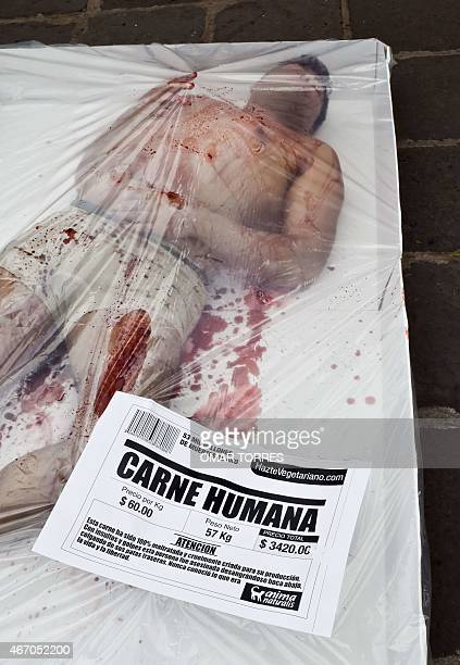 A member of the Animal Naturalis organization lays covered in fake blood in a simulated supermarket tray during a demonstration commemorating...