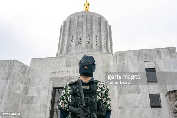 Member of the anti-government group, The Boogaloo Boys, protests on January 17, 2021 in Salem, Oregon. Protesters gathered at state capitol buildings...