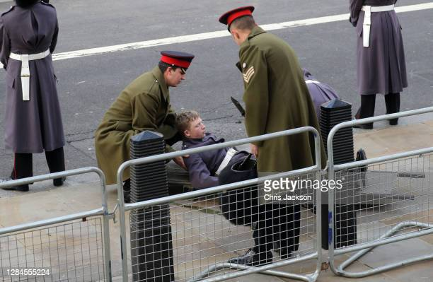 Member of the Armed Forces is taken ill during the National Service of Remembrance at The Cenotaph on November 08, 2020 in London, England....