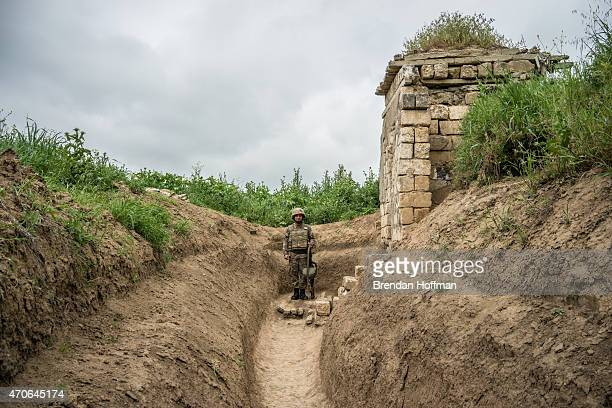 Member of the armed forces of Nagorno-Karabakh at their post along the line of contact with Azerbaijani forces in the eastern direction on April 21,...