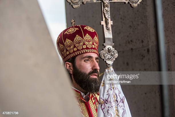 A member of the Armenian Apostolic Church participates in a canonization ceremony for victims of the Armenian genocide at the Mother See of Holy...