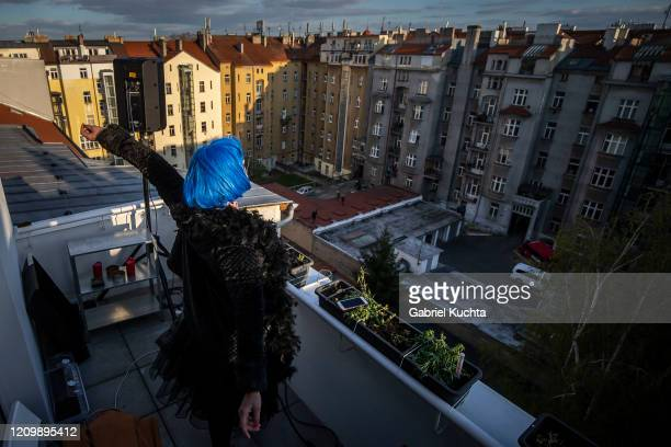 Member of the artistic group Cirk La Putyka performs to entertain residents as the spread of the coronavirus disease continues on April 14 2020 in...