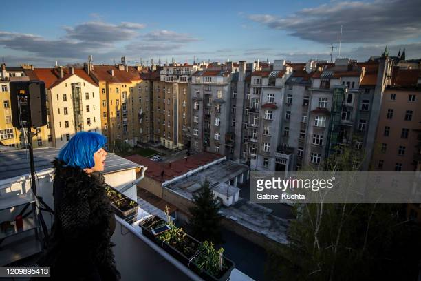 Member of the artistic group Cirk La Putyka performs to entertain residents as the spread of the coronavirus disease continues on April 14, 2020 in...