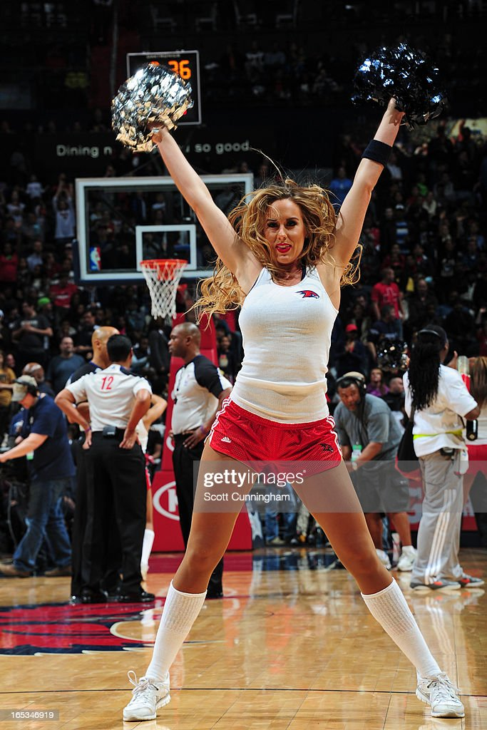 A member of the Atlanta Hawks dance team performs during halftime of the game against the Portland Trail Blazers on March 22, 2013 at Philips Arena in Atlanta, Georgia.