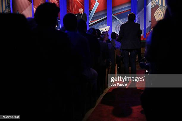 A member of the audience asks democratic Presidential candidates Sen Bernie Sanders a question during a CNN and the New Hampshire Democratic Party...