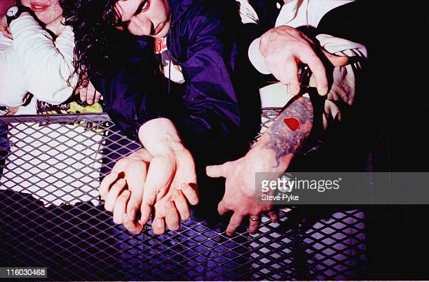 A member of the audience at a concert by American rock group Nirvana shows off a tattoo Belfast 1992