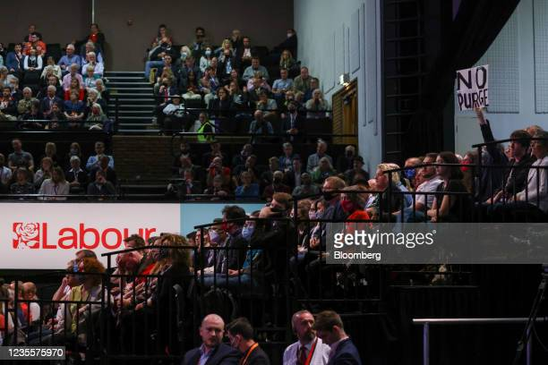 """Member of the audience holds a sign that reads """"No Purge"""" as Keir Starmer, leader of the Labour Party, delivers his keynote speech during the annual..."""