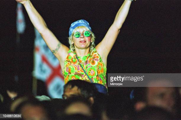 Member of the audience shows her appreciating for Travis during their performance on the pyramid stage at Glastonbury 24th June 2000.