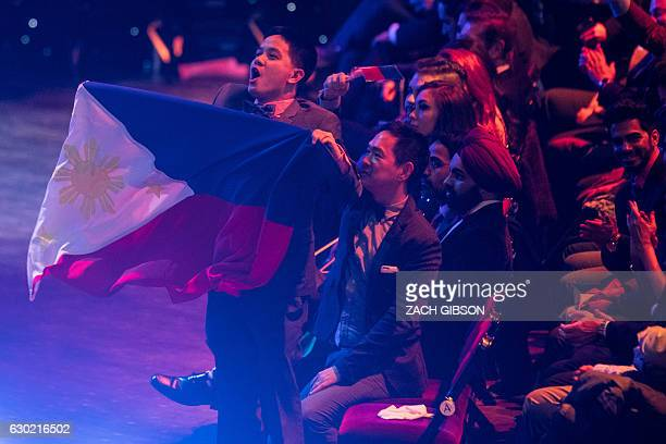 A member of the audience waves the Philippines flag during the Grand Final of the Miss World 2016 pageant at the MGM National Harbor December 18 2016...