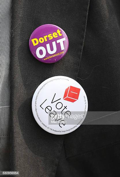 A member of the audience wears badges as Boris Johnson visits Reidsteel a Christchurch company backing the Leave Vote on the 23rd June 2016 on May 12...
