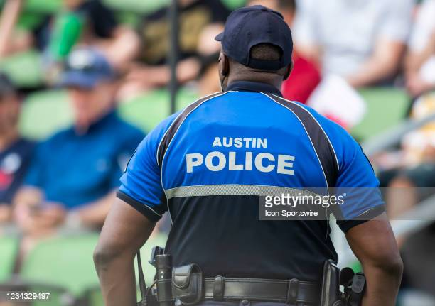 Member of the Austin, Texas police department stands watch during the Gold Cup semifinal match between the United States and Qatar on Thursday July...
