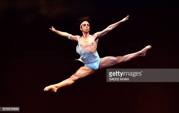 A member of the Australian ballet performs in the scene from 'iana and Acteon' during the dress rehearsal for the national premiere of Symphony in C...