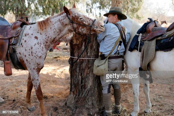A member of the Australian Light Horse association prepares his horse on October 29 2017 near BeerSheva on the northern Israeli desert during a...