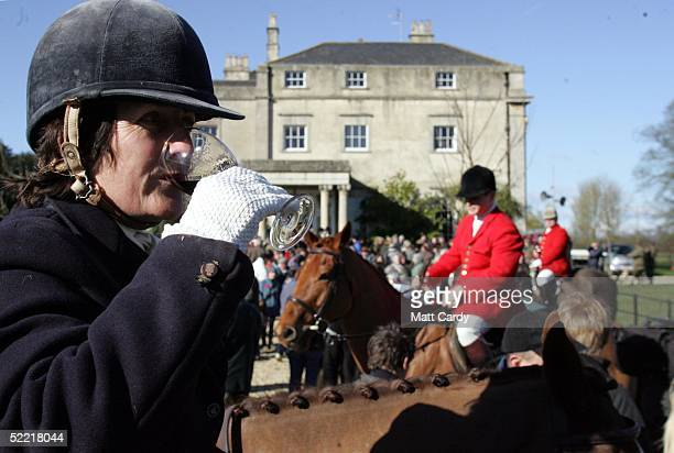 A member of the Avon Vale hunt sips her glass of port prior to setting out at the Avon Vale Hunt at Monk's Park on February 19 2005 near Corsham...