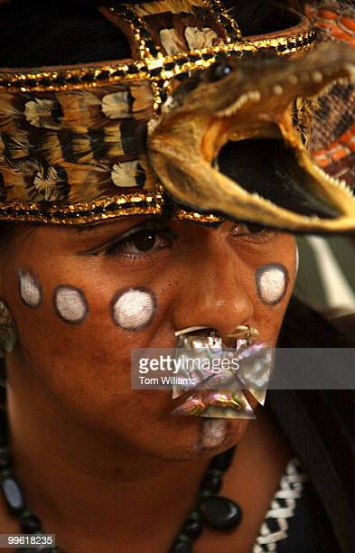 A member of the Aztec Culture of Mexico prepares to perform with a customary dance routine on the Mall as part of the opening ceremonies for the...