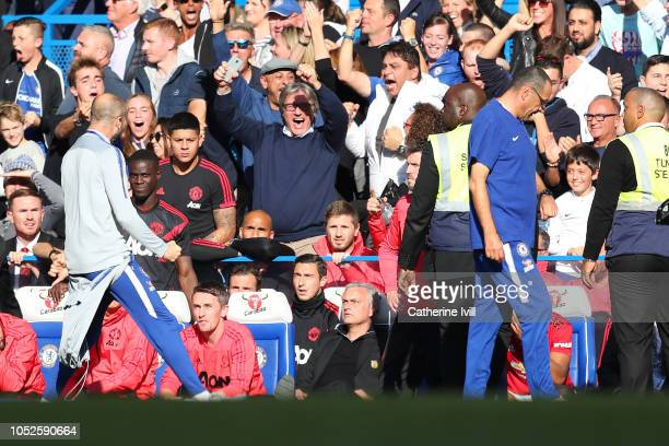 A member of the backroom staff at Chelsea celebrates his sides second goal infront of Jose Mourinho Manager of Manchester Unied during the Premier...