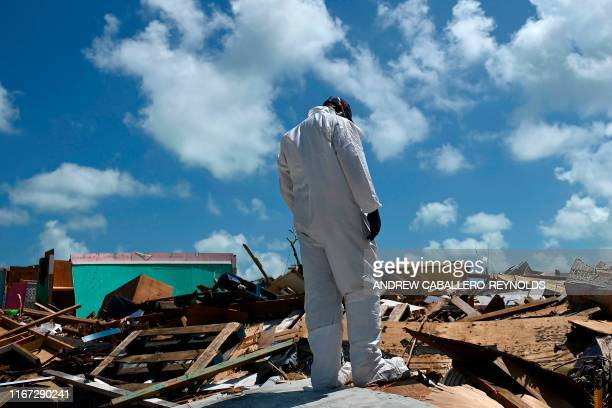 A member of the Bahamanian body recovery team looks on as he takes a break during a search operation in Marsh Harbour Bahamas on September 10 one...