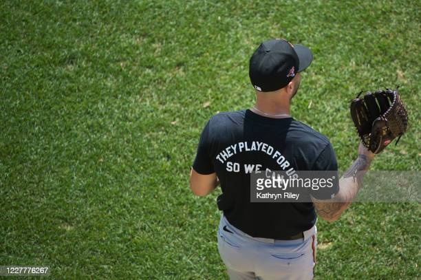 Member of the Baltimore Orioles wears a t shirt honoring the Negro League during batting practice prior to the start of the game against the Boston...