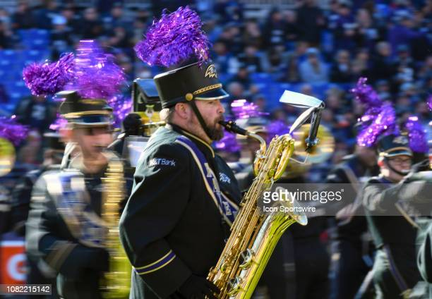 A member of the Baltimore Ravens marching band performs prior to the game against the Los Angeles Chargers on January 6 at MT Bank Stadium in...