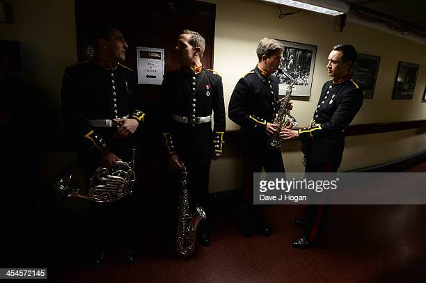 A member of The Band Of Her Majesty's Royal Marines warms up backstage at The Royal Albert Hall on December 9 2013 in London England
