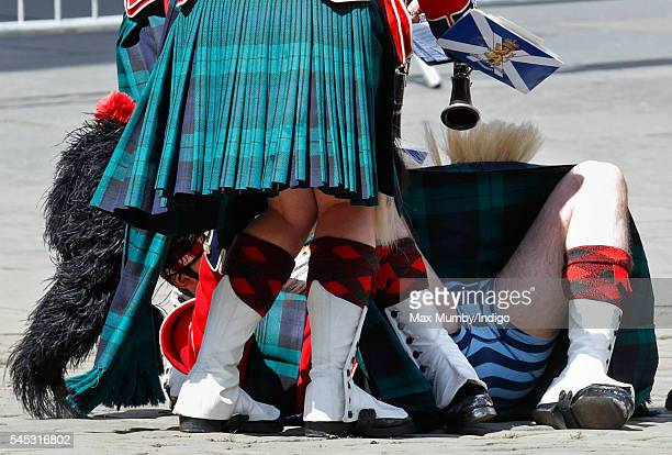 A member of the Band of the Royal Regiment of Scotland collapses during the Thistle Service at St Giles' Cathedral on July 7 2016 in Edinburgh...