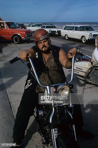 A member of the Bandidos gang shot on a motorbike on a coastal street Texas September 1969