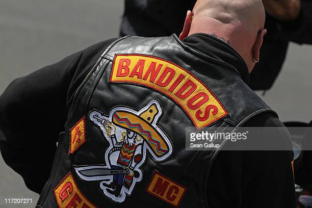 A member of the Bandidos motorcycle gang sits on his motorcycle outside the Bandidos Berlin Eastgate club on June 24 2011 in Berlin Germany Both the...