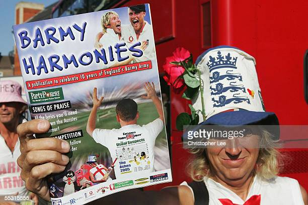 A member of the Barmy Army hands out programs with songs during the Npower Ashes 5th Match between England and Australia at the Brit Oval on...
