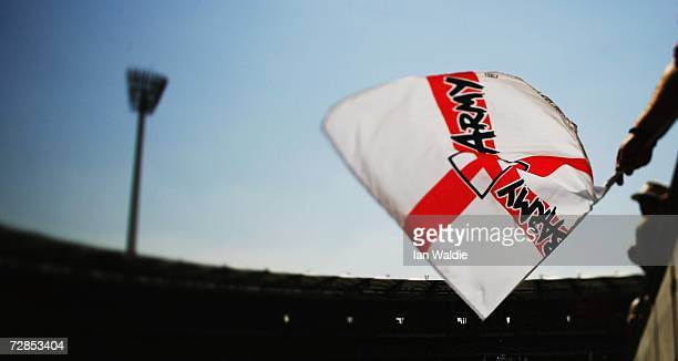 A member of the Barmy Army waves a flag at the Gabba cricket ground during the first Ashes test November 24 2006 in Brisbane Australia The Ashes are...