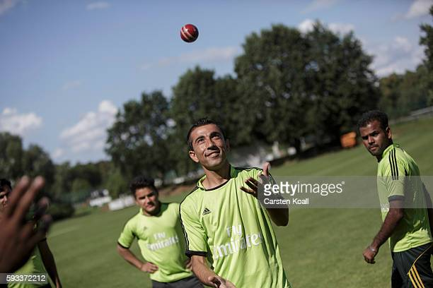 A member of the Bautzen cricket team juggles with a cricket ball during a break in a friendly match against the Dresden cricket team on August 21...