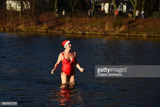 A member of the Berliner Seehunde swimming club wears a Christmas cap as she attends their traditional Christmas swimming on December 25 2015 at the...