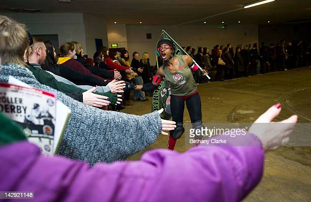 Member of the Birmingham Blitz Dames interacts with the crowd after a Rollergirls Roller Derby event on April 14, 2012 in Oldham, England. The...