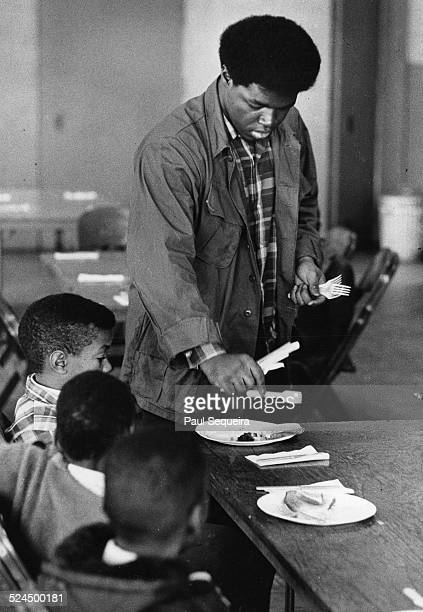 A member of the Black Panthers served children meals during a Black Panther Free Breakfast for Children Program Chicago Illinois 1969