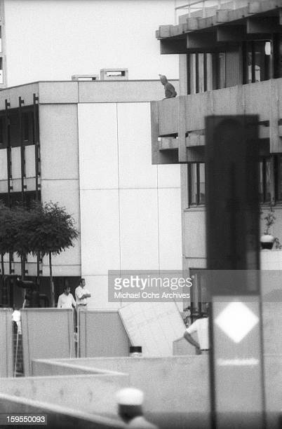 A member of the Black September Organization stands on the balcony of the Israili Olympic team quarters where the group are holding 9 surviving...