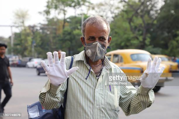 Member of the Blind organization showing hands with sterile gloves Blind organization of the city of Joy organised a social awareness program to...