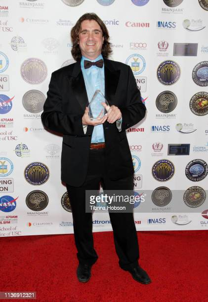 Member of the Board of Brain Mapping Foundation Dr Harry Kloor receives the Golden Axon Award at the 16th annual 'Gathering for Cure' black tie...
