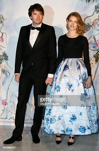 LVMH member of the board of directors Antoine Arnault and his wife Russian model Natalia Vodianova pose prior to attend the Bal de la Rose du Rocher...