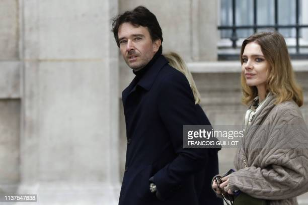 Member of the board of directors of LVMH Antoine Arnault and his partner Natalia Vodianova arrive at Notre-Dame-de Paris Cathedral a day after a fire...