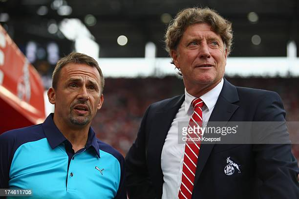 Member of the board Thomas Allofs of Duesseldorf and president Toni Schumacher of Koeln look on prior to the Second Bundesliga match between 1 FC...