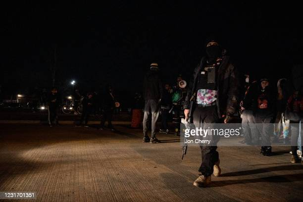 Member of the Boggaloo Bois Marches with a group of protesters at night after the Breonna Taylor memorial events on March 13, 2021 in Louisville,...