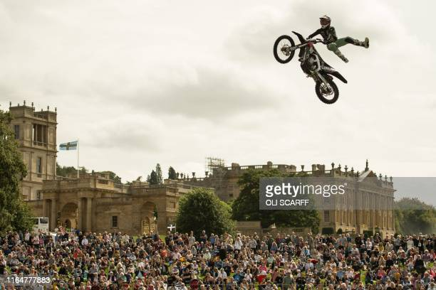 Member of the Bolddog Lings FMX Display Team performs in the Grand Ring on the first day of the Chatsworth Country Fair in the grounds of Chatsworth...