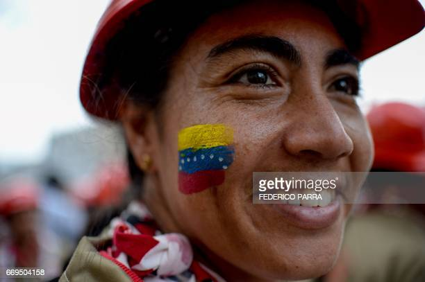 TOPSHOT A member of the Bolivarian Militia smiles during a parade in the framework of the seventh anniversary of the force in front of the Miraflores...