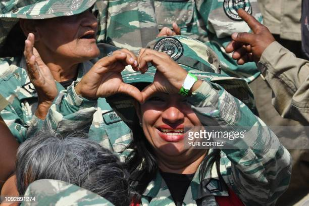 A member of the Bolivarian militia supporter of Venezuelan President Nicolas Maduro gestures during a gathering to mark the 20th anniversary of the...